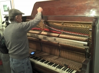 The piano tuner working his magic
